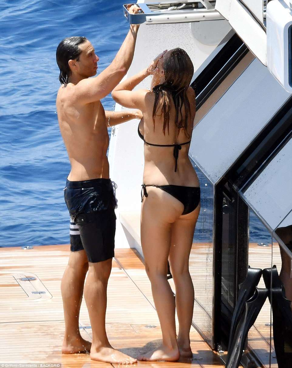 Extreme luxury: The power couple made sure that stayed fresh by showering off on the back of the famed yacht