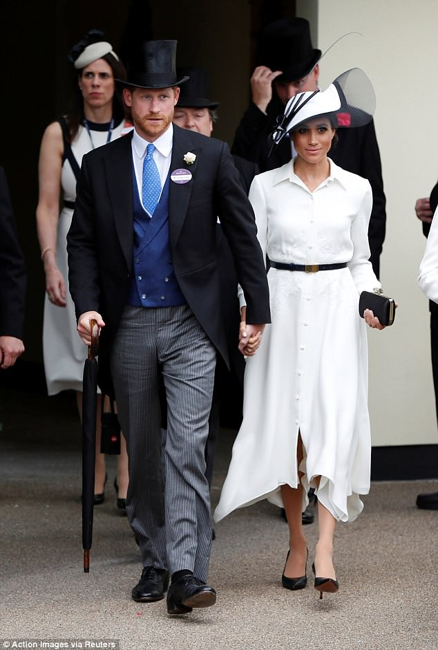 Meghan has been favouring the clutch bag at recent royal events, including at Ascot (above)