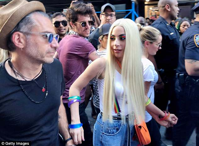 Couple of cuties: Gaga marched with her fiance Christian Carino