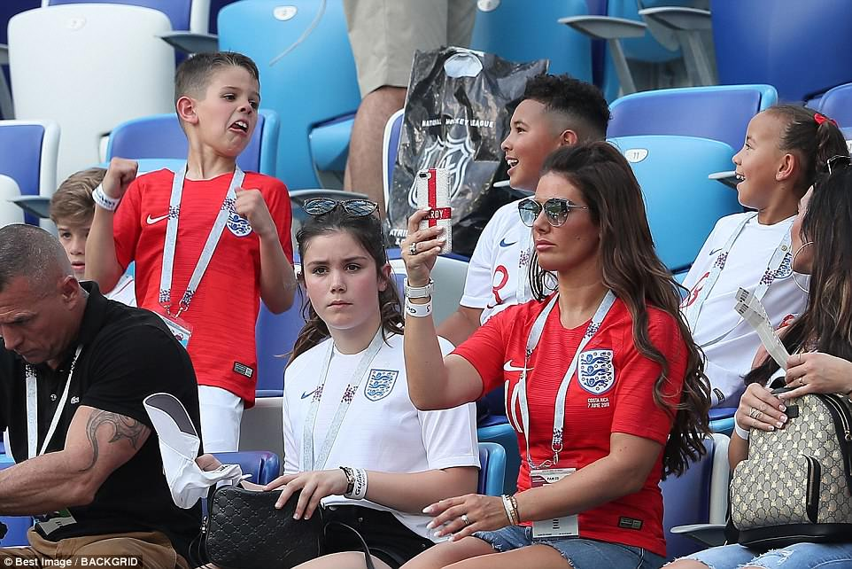 Rebekah (far right) was seen taking a picture on her phone during the impressive England victory against Panama today