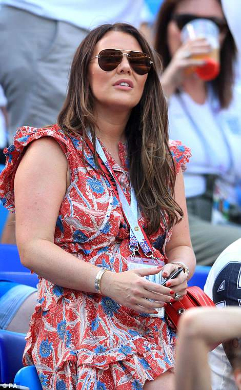 Defender Ashley Young's wife, Nicky Pike, opted for a floral dress as she watched the match