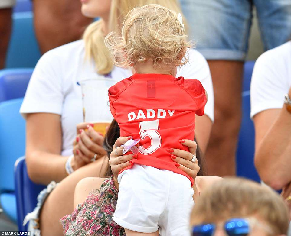 The toddler sported a shirt saying 'Daddy' on the back
