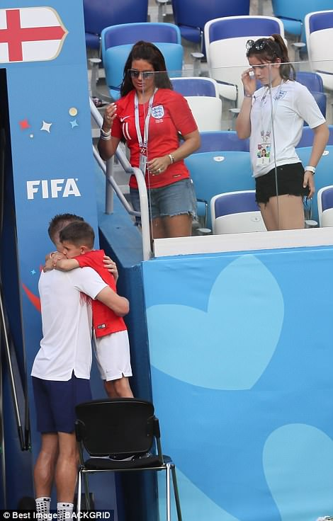 Jamie was seen giving his son a hug after the game