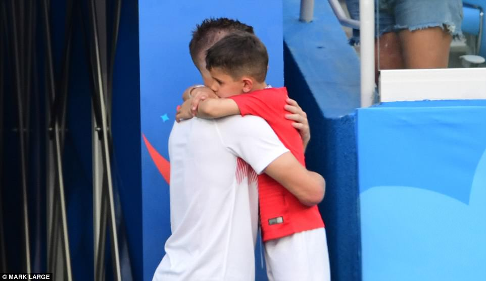 Vardy was seen giving his step-son Taylor, six, a sweet embrace following England's incredible victory against Panama today