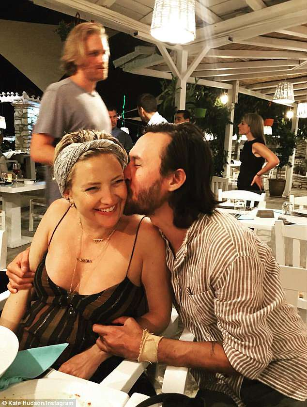 So loved up: The actress, 39, been enjoying a relaxing break on the Greek islands with boyfriend Danny Fujikawa and her extended family and friends