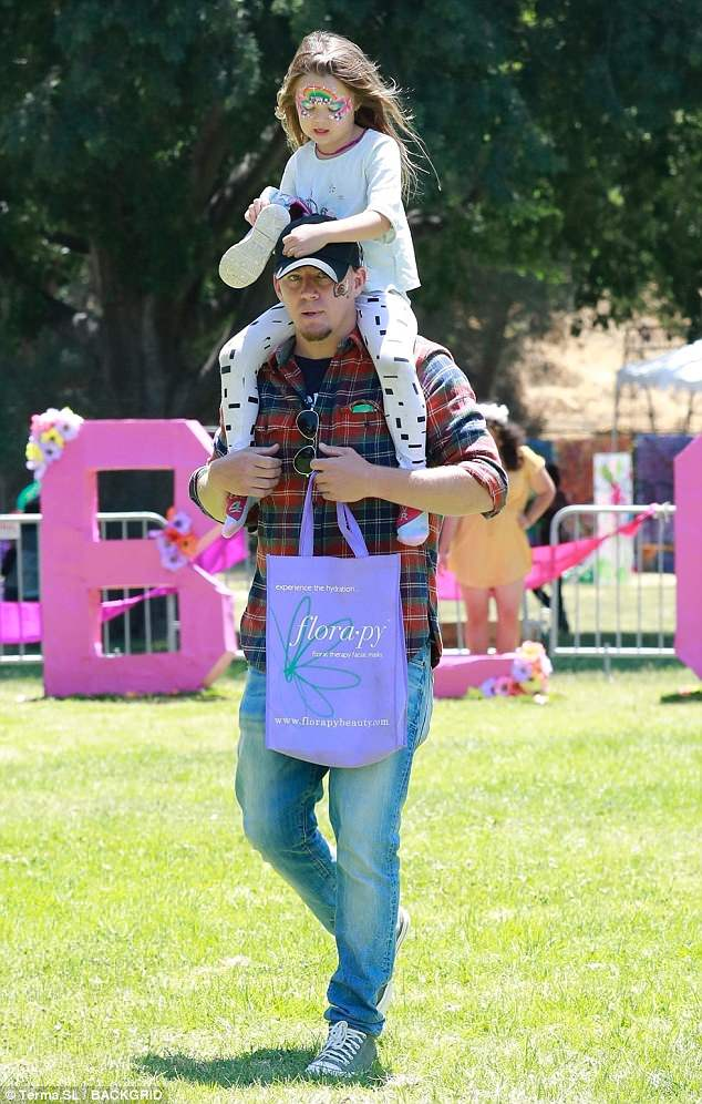 Doting dad:Channing Tatum proved on trend as he was spotted hanging out with his five-year-old daughter Everly in Los Angeles on Sunday