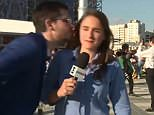 Julia Guimarães was filming to camera when a football fan approached and tried to kiss her