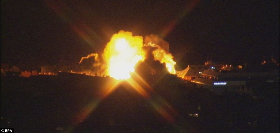 Blast: The huge explosion sent clouds of debris into the air after the controlled detonation