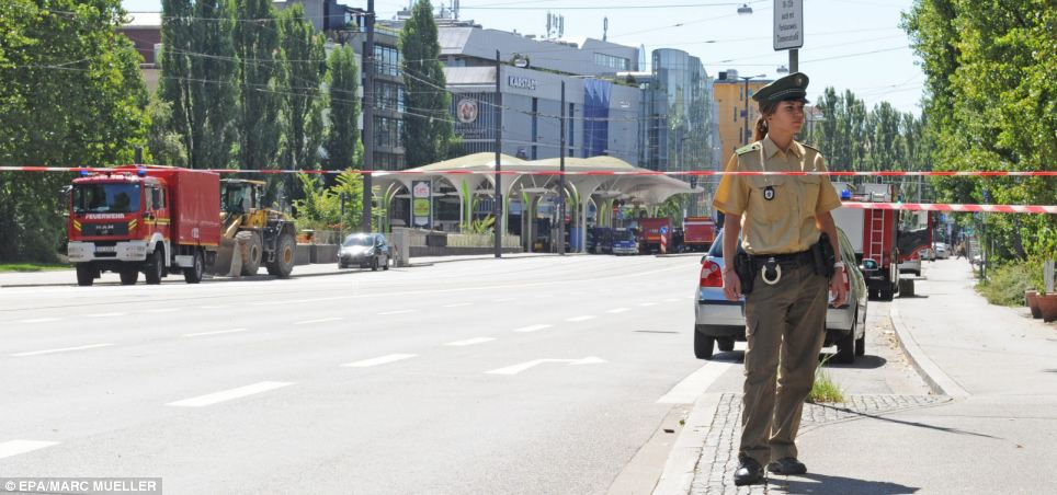 Secure: Police were out in force on the streets of Munich to keep people away from the scene of the detonation