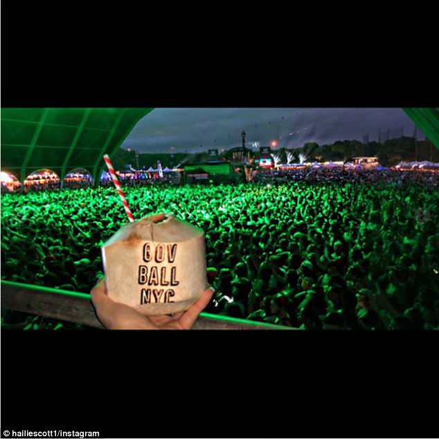 Nice seats: In one she showed off her view for her father's headlining set at Governors Ball in New York City, as she sipped from a branded coconut above a capacity packed crowd