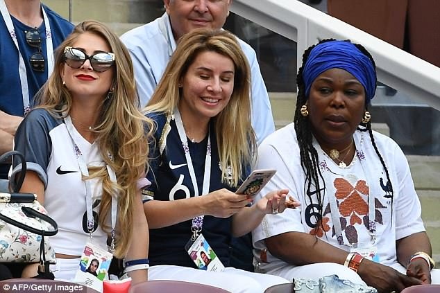In good company: Maria She was also accompanied by Paul's doing mother Weo (far right) and the pair sat side by side as they watched the match