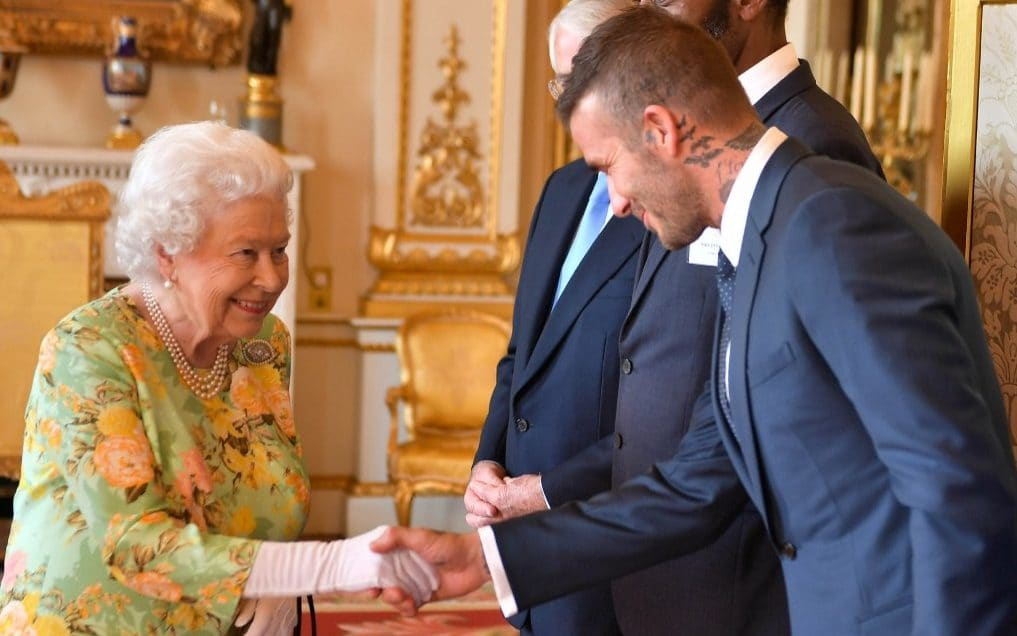 The Queen meeting David Beckham at Buckingham Palace