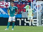Goalkeeper Manuel Neuer of Germany looks dejected as his team crash out of the competition