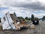 Photos released by police in Washington state show a couple's brand new travel trailer scattered in pieces along an interstate