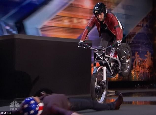 Dangerous act: Motorcycle trick rider Kenny Thomas from Paris used Howie during his act