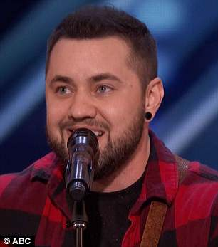 Standing ovation: The Nebraska singer earned a standing ovation after his performance