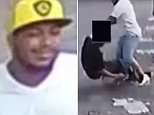 The suspect winds up to punch the 37-year-old in the middle of the street, with the suspect's friend looking on