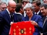 The Prime Minister ensured some awkward banter at a summit in Brussels as she was presented with her own shirt by Belgian counterpart Charles Michel (pictured)