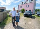 Nigel and Sheila Jacklin, who live in the house pictured on the right, have been banned from 'looking in the windows' of their neighbours house, left, following a planning dispute