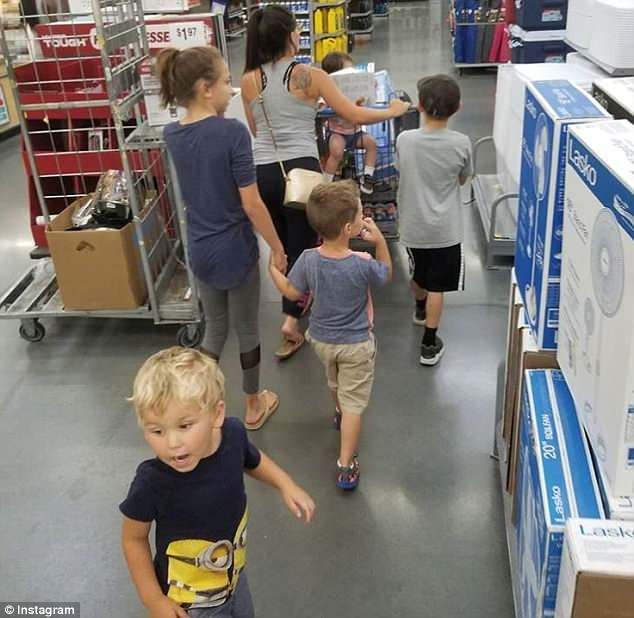 Out and about: Eason shared this shot of the family's trip to Walmart