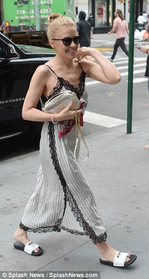 Details: She carried a small beige bag in her arm which matched her dress perfectly and had artfully tied a red scarf onto one of the straps which added a pop of colour
