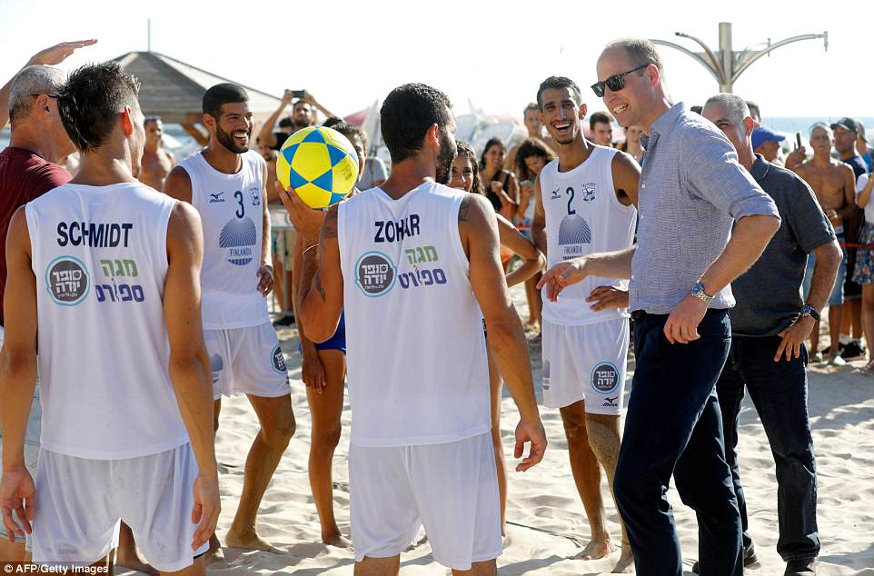 William speaks to beach volleyball players during a visit with the mayor of Tel Aviv to a beach in the coastal Israeli city