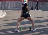 Platon Besedinwrote in Moskovsky Komsomolets: 'Social networks are overloaded with videos where young and not quite young Russian women are behaving like overused prostitutes with low social responsibility'. Pictured: A Russian woman makes a goal with her legs for Uruguay fans