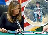 Rodolfo Karisch, Chief Patrol Agent of the Tucson Sector Border Patrol shows Mrs Trump a photo of the unnamed boy at aU.S. Customs and border and protection facility in Tucson