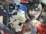 Surrey Police tweeted this image of the vehicle which was filled with clutter