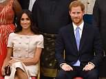 Meghan Markle has come under fire for allegedly trying to hold Prince Harry's hand during an event at Buckingham Palace on Tuesday