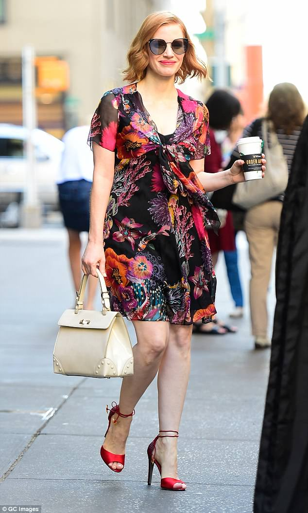 Flower power: Jessica Chastain looked absolutely stunning in a floral mini dress while out and about in New York City on Tuesday morning