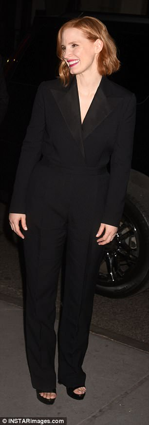 Suited and booted: On Monday Jessica was also spotted looking effortlessly chic in a plunging black trouser suit while attending a screening in New York's Museum of Modern Art