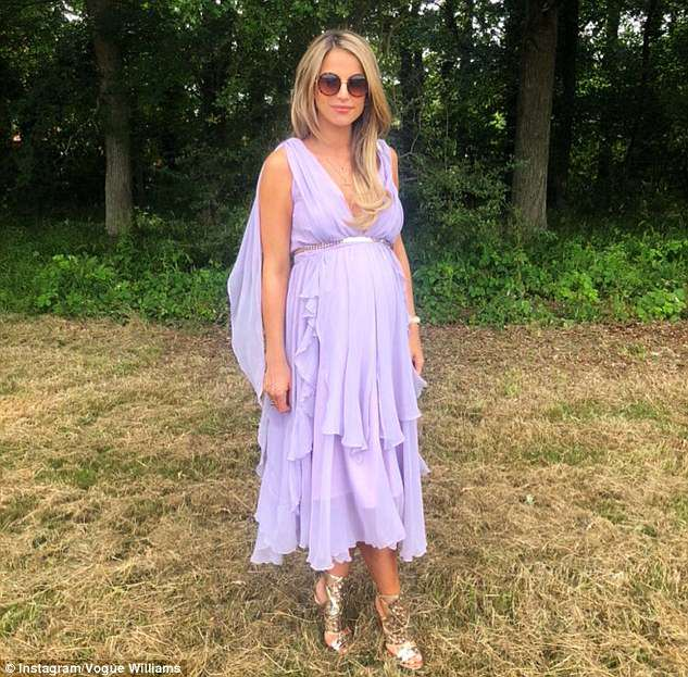 Yummy mummy: The Irish model, 32, looked comfortable as she attended Hugo Taylor and Millie Mackintosh's wedding on Saturday, opting for a stunning Helen Steele lavender gown