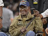 """FILE - In this March 23, 2017, file photo, Richard Overton leaves the court after a special presentation honoring him as the oldest living American war veteran, during a timeout in an NBA basketball game between the Memphis Grizzlies and the San Antonio Spurs.  The family of Richard Overton says Social Security and banking account numbers for the 112-year-old Austin man were used to make seven withdrawals over the past several months. Cousin Volma Overton declined to say how much was stolen but said it was a """"significant amount of money.""""  He says the money was used to purchase savings bonds. A police report was filed Friday, June 30, 2018.   (AP Photo/Darren Abate, File)"""