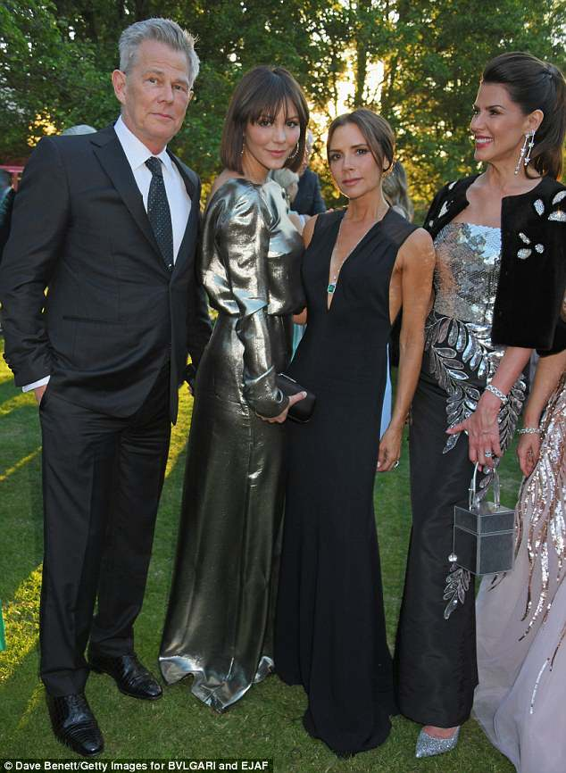 Strike a pose: Katharine stunned in a silver full-length gown; David and Katharine chatted it up with Victoria Beckham and Christina Estrada at the gala