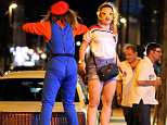 These two revellers in Blackpool donned fancy dress for their night out, with one dressed as Mario and the other in an England shirt