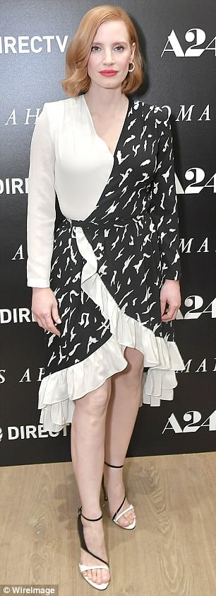 Foot forward: The Help star completed her outfit with open-toed black and white collar heels