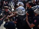Riot police beats a LGBT rights activist who gathered for the Pride event in Istanbul on Sunday