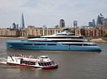 London-born businessman Joe Lewis's super yacht Aviva was pictured sailing along the River Thames earlier today