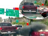 In a video filmed on June 28 in Tacoma, Washington, a red burgundy Dodge truck is trying to merge into an exit lane off the highway, but the red Corvette doesn't let him in and rolls down his window to flip him the bird