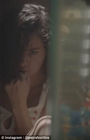 Creepy: Part of the clip also sees Selena chew on what appears to be a finger