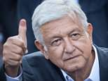 First Sighting: Newly elected Mexico's President Andres Manuel Lopez Obrador waves to his supporters from a hotel after winning general elections in Mexico City on Sunday
