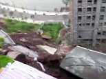 Terrifying footage has emerged of the moment a fifty-metre section of a major road collapses (pictured)
