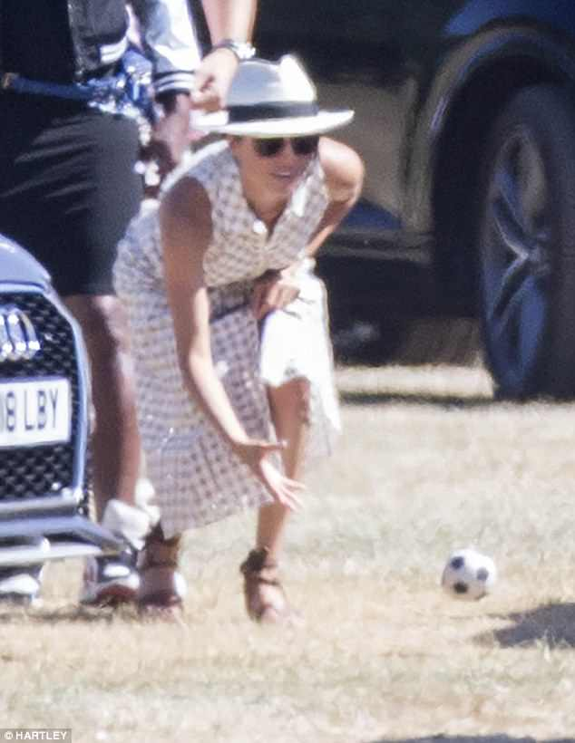 Meghan was pictured throwing a mini football while at theAudi Polo Challenge in Ascot, Berkshire, on Saturday, drawing comparisons with Princess Diana