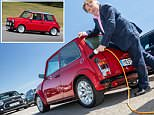 Superb or sacrilege? Daily Mail motoring editor Ray Massey pictured with the classic Mini Electric