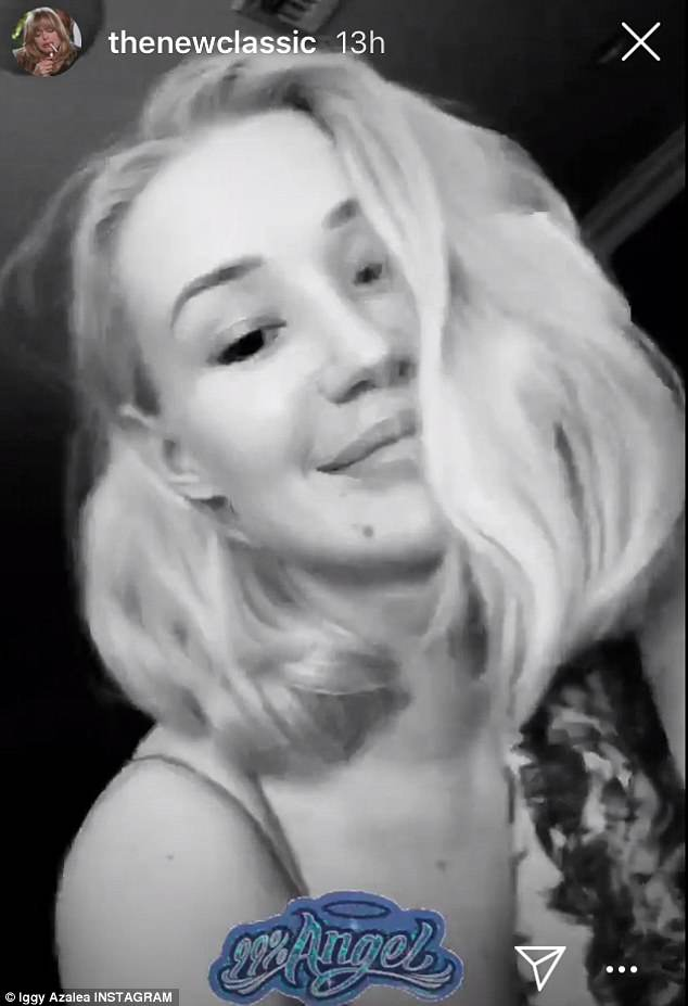 Back at it: Iggy Azalea flaunted enviable curves in a seductive bedroom snap on Monay - following her post defending her X-rated posts