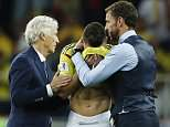 Colombia head coach Jose Pekerman, left, and England head coach Gareth Southgate, right, comfort Colombia's Mateus Uribe after the round of 16 match between Colombia and England