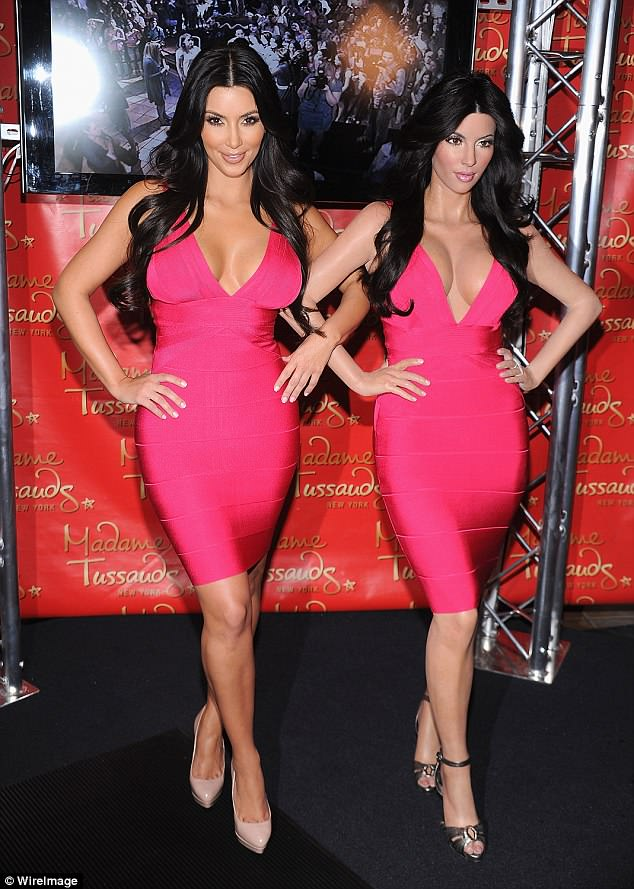 In the past: Kardashian's first wax figure in 2010 rocked a tight red dress with ample cleavage