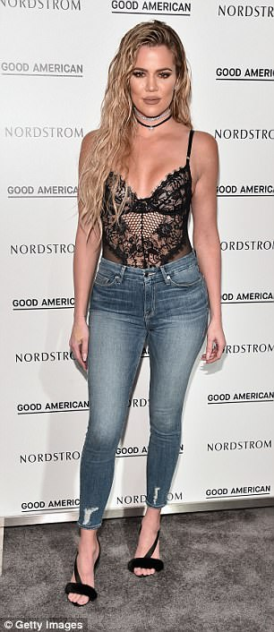Double take: The real Kardashian sported this look in October 2016 during the launch of her designer label Good American