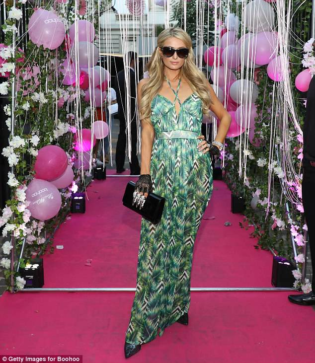 Mane attraction: Paris continued her glamorous appearance in the City of Lights as she styled her extension-laden mane